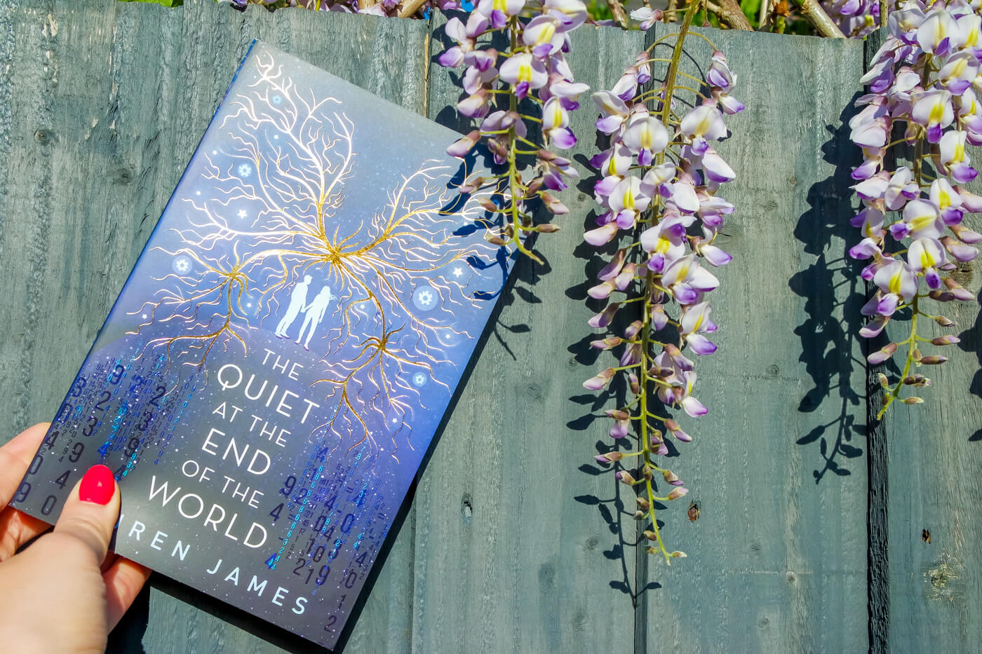 The quiet at the End of the World book cover in the garden